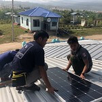 Solar_panels_installing_on_roof_Myanmar